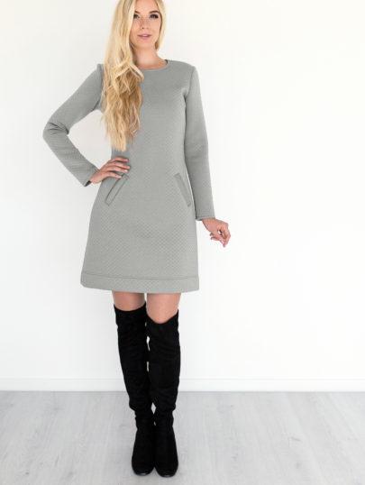 Pilka tiesi suknele